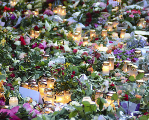 Flowers and candles set out at a memorial service